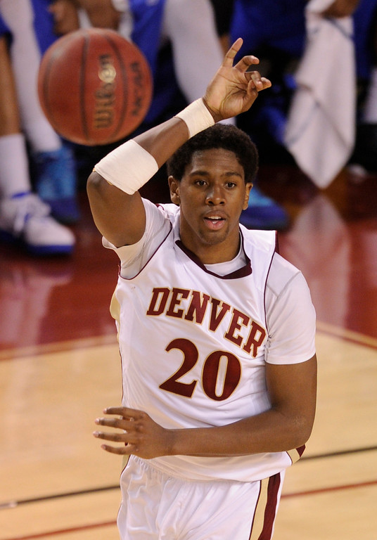 . Denver forward Royce O\'Neale (20) made a pass in the second half. The University of Denver men\'s basketball team defeated the Louisiana Tech Bulldogs 78-54 at Magness Arena Saturday night, March 9, 2013. (Photo By Karl Gehring/The Denver Post)