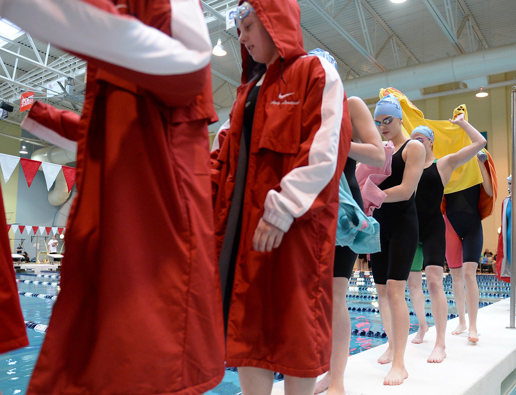 . THORNTON, CO. - FEBRUARY 15, 2014: Competitors in the 200-yard medley relay headed to the starting blocks Saturday. The CHSAA 5A Girl\'s State Swimming Championships wrapped up Saturday night February 14, 2104.  Photo By Karl Gehring/The Denver Post
