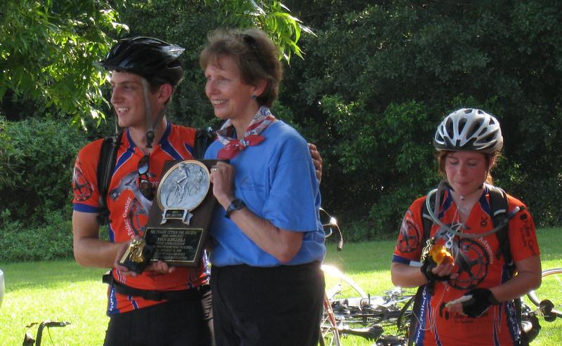 09 08 Linda Fuller presents Ryan Iafigiola with the Bike Adventure commemorative plaque. lcf