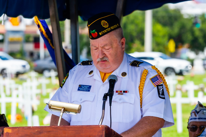 Paul Reinsborrow, a member of the Honor Guard of American Legion Post 164 reads the names of veterans who have passed away in the past year during the Memorial Day Observance at Boynton Beach Memorial Park on Sunday, May 26, 2019. [JOSEPH FORZANO/palmbeachpost.com]