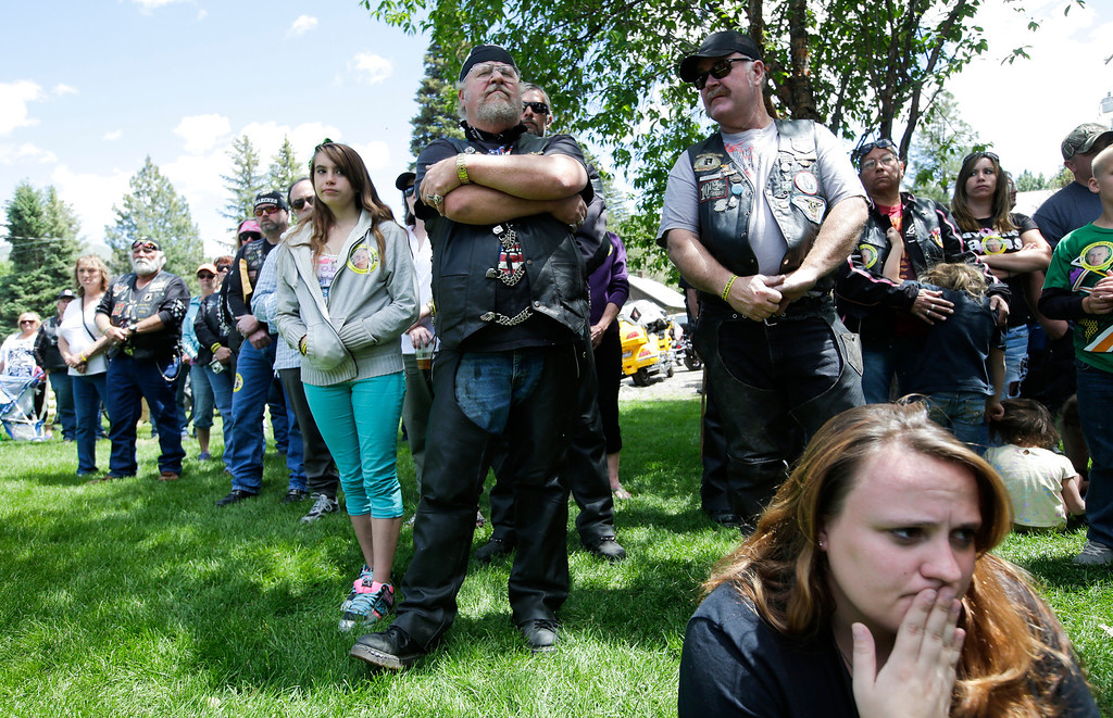 """. Supporters listen to a speaker at the \""""Bring Bowe Back\"""" celebration held to honor captive U.S. Army Sgt. Bowe Bergdahl in Hailey, Idaho, Saturday, June 22, 2013. Hundreds of activists for missing service members gathered in a small Idaho town Saturday to hear the parents of the only known U.S. prisoner of war speak just days after his Taliban captors announced they want to exchange him for prisoners being held at Guantanamo Bay. (AP Photo/Jae C. Hong)"""