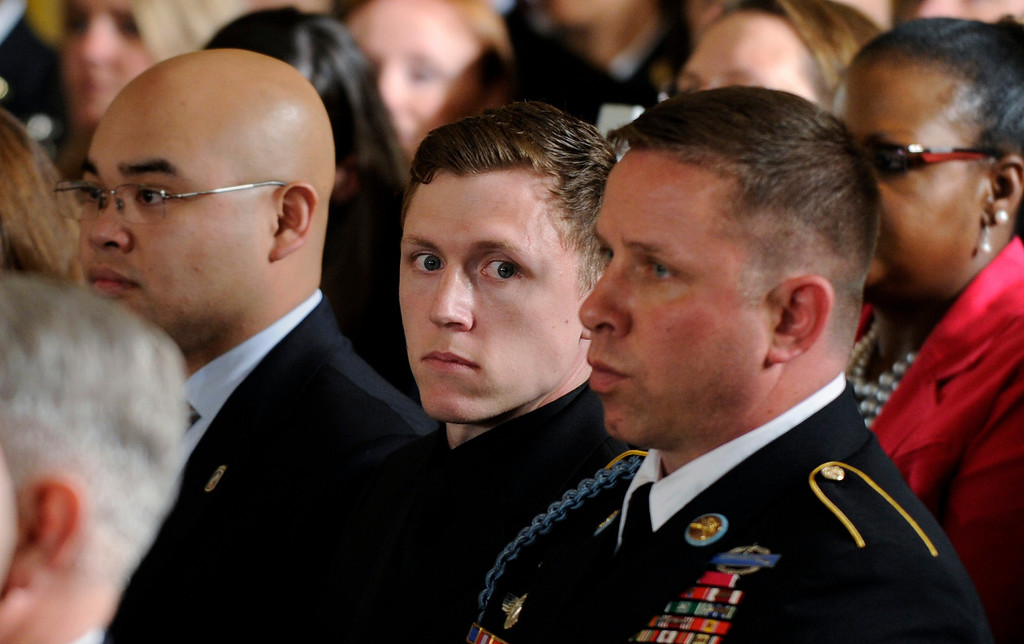 . Former Spc. Kain Schilling attends the ceremony in the East Room of the White House in Washington, Tuesday, May 13, 2014, where President Barack Obama awarded the Medal of Honor to former Army Sgt. Kyle J. White.  (AP Photo)