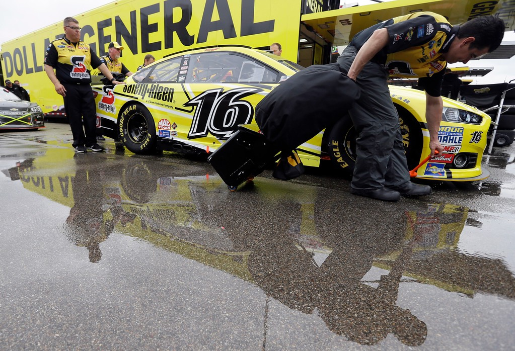 . Greg Biffle\'s car waits for inspection before the NASCAR Sprint Cup series auto race at Michigan International Speedway, Sunday, June 14, 2015, in Brooklyn, Mich. (AP Photo/Carlos Osorio)
