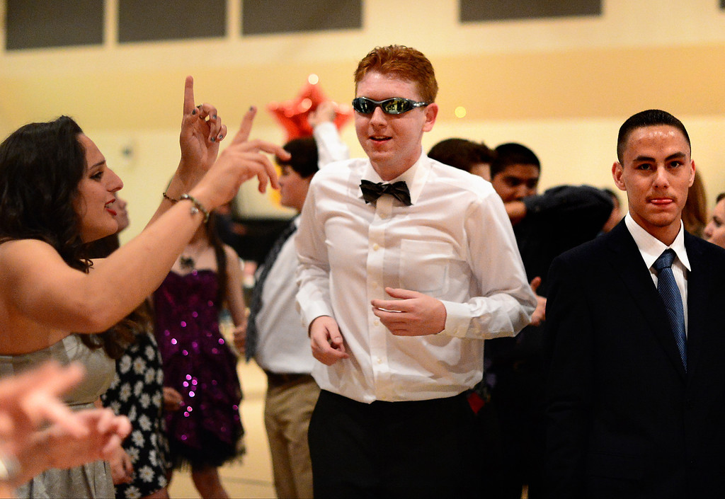 . David Napolitano, center, dances during Glendora High School\'s Best Buddies Prom for high school students with special needs Friday night, April 19, 2013 at the Glendora campus. (SGVN/Staff Photo by Sarah Reingewirtz)