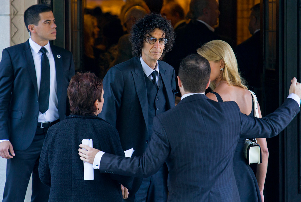 . Howard Stern, center, arrives at a funeral service for comedian Joan Rivers at Temple Emanu-El in New York, Sunday, Sept. 7, 2014. Rivers died Thursday, Sept. 4, 2014. She was 81. (AP Photo/Craig Ruttle)