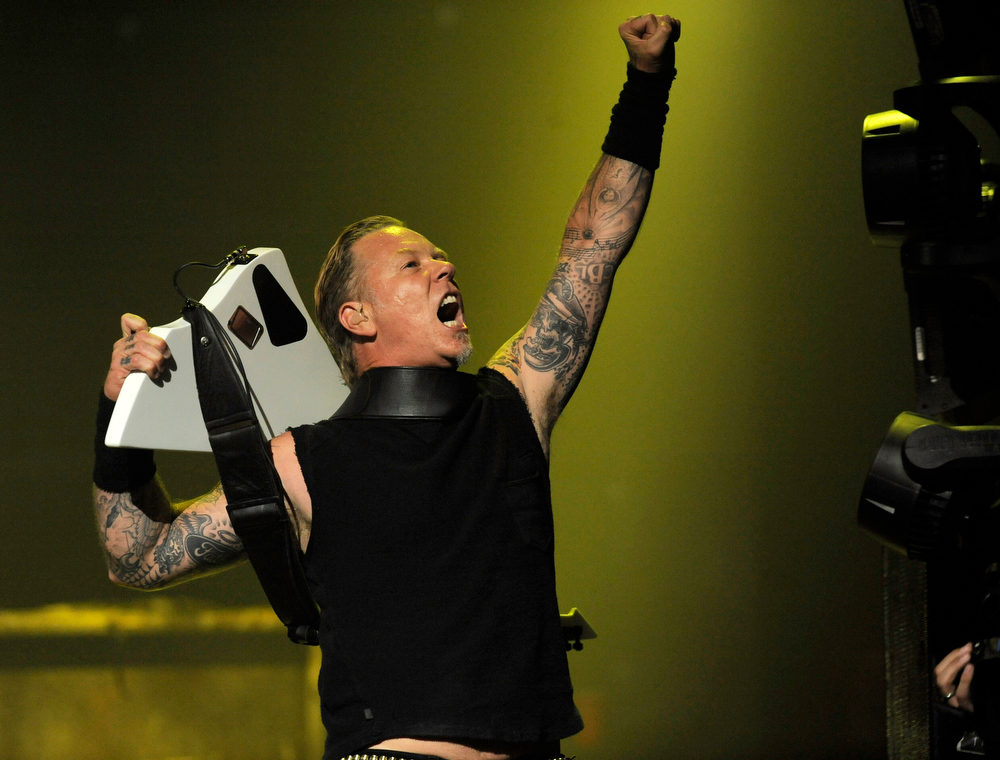 . James Hetfield of Metallica gestures to the balcony during the band\'s set at the 2013 Revolver Golden Gods Award Show at Club Nokia on Thursday, May 2, 2013 in Los Angeles. (Photo by Chris Pizzello/Invision/AP)