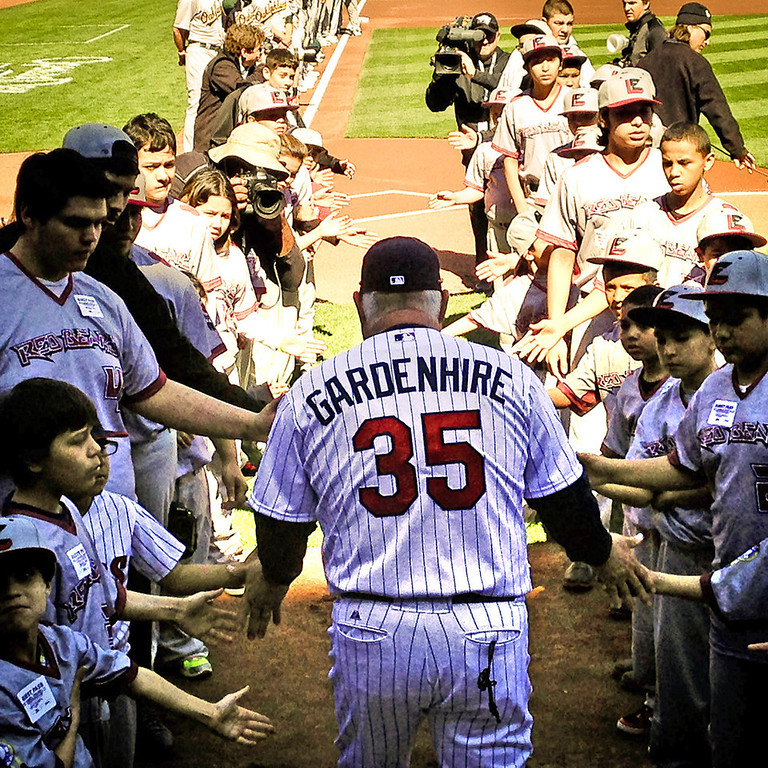 . Minnesota Twins manager Ron Gardenhire is greeted by members of the Little Earth Red Bears youth baseball team as comes on the field for introductions before the Twins play the Oakland Athletics for their home opener at Target Field in Minneapolis on Monday, April 7, 2014. Gardenhire, who was named the Twins manager in Jan. 2002, won his 1,000th career game Saturday at Cleveland. (Pioneer Press: Ben Garvin)