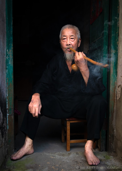 Portrait of a local cormorant fisherman at his home in the river town of Xingping, China.