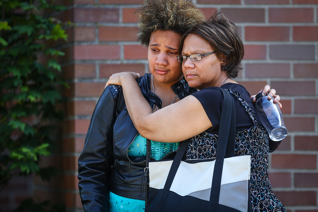 . Onlookers embrace near the scene of a shooting at Seattle Pacific University on Thursday, June 5, 2014 in Seattle. About 4,270 students attend the private Christian university, located in a residential neighborhood about 10 minutes from downtown Seattle. (AP Photo/seattlepi.com, Joshua Trujillo)