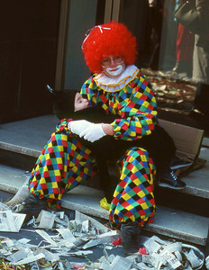 Taking a break.  This clown with his  little black cat were resting during a carnival in Germany.