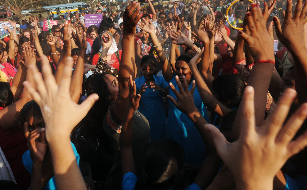 Description of . Members and supporters of various sexual minority groups dance during a protest meeting against all forms of physical and mental violence against women and girls all over the world, in Kolkata on February 14, 2013.  Indians were at the forefront of global protests on Thursday in the One Billion Rising campaign for women's rights, galvanised by the recent fatal gangrape that shocked the country. DIBYANGSHU SARKAR/AFP/Getty Images