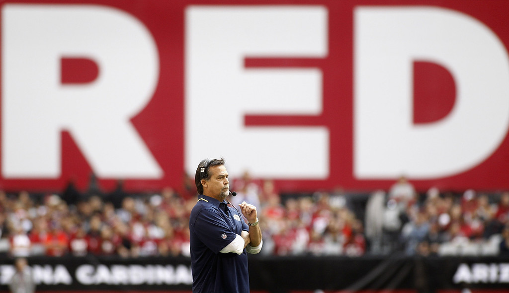 . Head coach Jeff Fisher of the St Louis Rams looks on from the sideline after the Arizona Cardinals scored a touchdown during the first quarter of their NFL football game at University of Phoenix Stadium on December 8, 2013 in Glendale, Arizona.  (Photo by Ralph Freso/Getty Images)