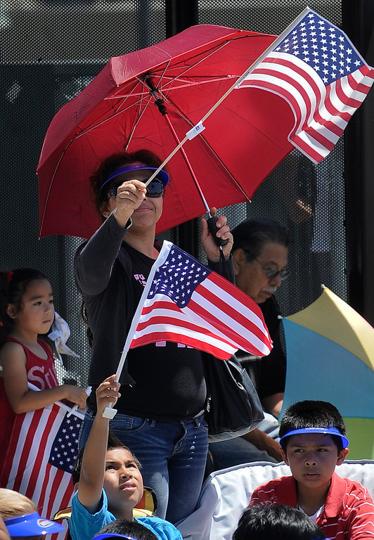 . Parade goers wave American flags during the Annual Canoga Park Memorial Day Parade marched down Sherman Way from Owensmouth east to Mason Street where it concluded at the First Baptist Church. Canoga park, CA 5/27/2013(John McCoy/LA Daily News)