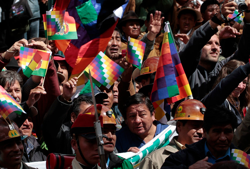 . Supporters of Bolivia\'s President Evo Morales participate in celebrations of third year of the new Pluri-national state of Bolivia and Morales\' eighth continuous year of government, the second longest government in the history of Bolivia, in La Paz January 22, 2013. Morales, first indigenous president in the country\'s history, will celebrate on Tuesday, 2558 days in the Bolivian Presidency. Morales took office on January 22, 2006, after winning the presidential election with 53.7% and he was re-elected for a second term on 2010-2015 with 64% of the votes according local media. REUTERS/David Mercado
