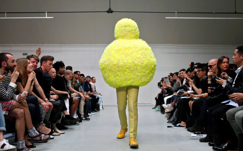 Description of . A model wears a creation by Belgian fashion designer Walter Van Beirendonck as part of his Spring/Summer 2012 fashion collection presented in Paris, Friday, June 24, 2011. (AP Photo/Thibault Camus)