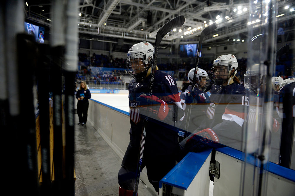 . U.S.A. women\'s hockey player Lyndsey Fry (18) walks off the ice with teammates after the conclusion of the second period of the United States\' 3-1 win against Finland. Sochi 2014 Winter Olympics on Saturday, February 8, 2014. (Photo by AAron Ontiveroz/The Denver Post)