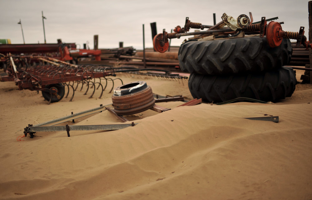 . Farm equipment at Ironwheel Ranch coved by dust from a recent storm in Lamar, Colorado on June 5, 2013. (Photo By Hyoung Chang/The Denver Post)
