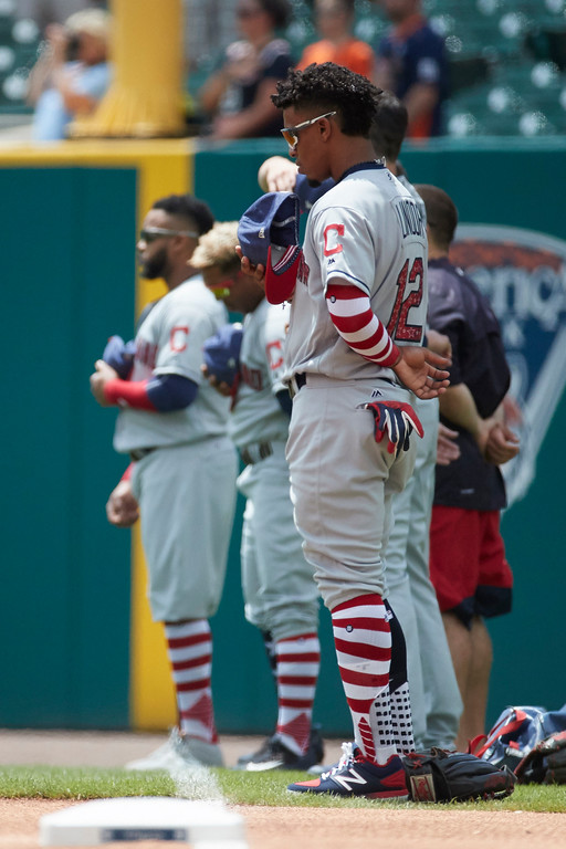 . Cleveland Indians shortstop Francisco Lindor (12) is seen during the national anthem prior to the first baseball game of a doubleheader against the Detroit Tigers in Detroit, Saturday, July 1, 2017. (AP Photo/Rick Osentoski)