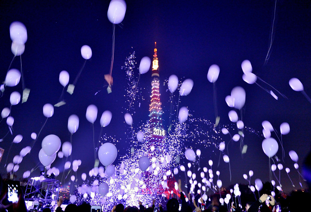 . People release balloons to celebrate the New Year during an annual countdown ceremony in Tokyo on January 1, 2014. Some 2,000 balloons were released in the air, carrying with the visitors\' wishes. KAZUHIRO NOGI/AFP/Getty Images