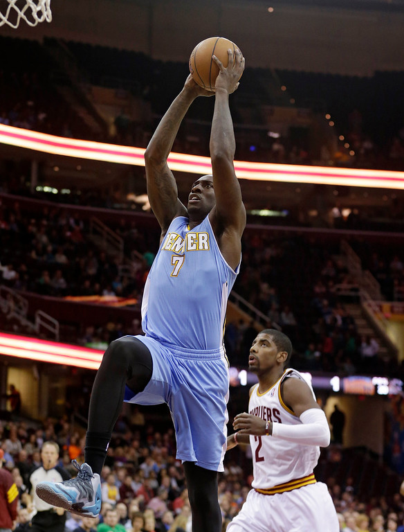 . Denver Nuggets\' J.J. Hickson (7) jumps to the basket against Cleveland Cavaliers\' Kyrie Irving (2) during the first quarter of an NBA basketball game on Wednesday, Dec. 4, 2013, in Cleveland. (AP Photo/Tony Dejak)