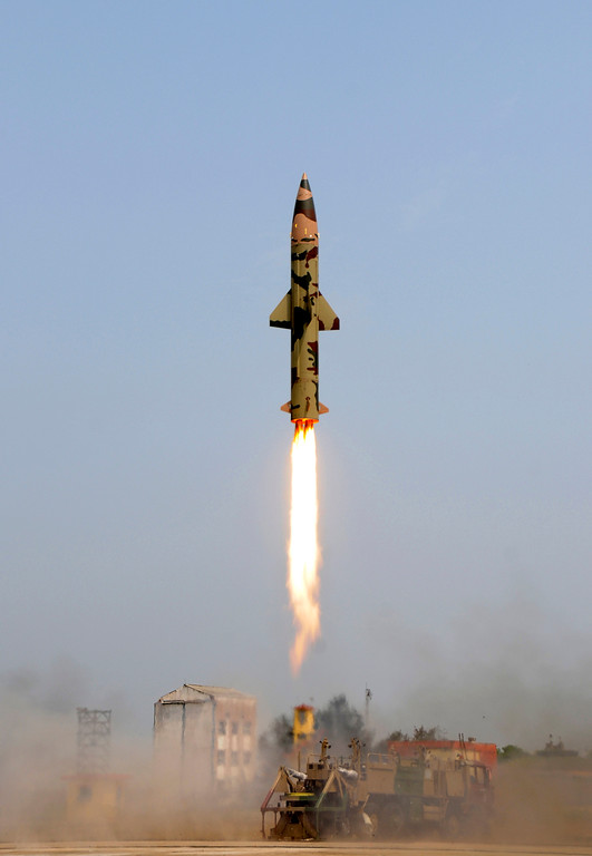 . In this photo provided by the Indian Press information Bureau, the nuclear-capable surface-to-surface Prithvi missile takes off from the missile testing range at Chandipur, India, Friday, March 11, 2011. India has tested two versions of its short-range missiles capable of carrying both conventional and nuclear warheads, a defense ministry official. The Prithvi missile, which can hit targets up to 185 miles (295 kilometers) away, is already in use by the Indian army. (AP Photo/Press Information Bureau)