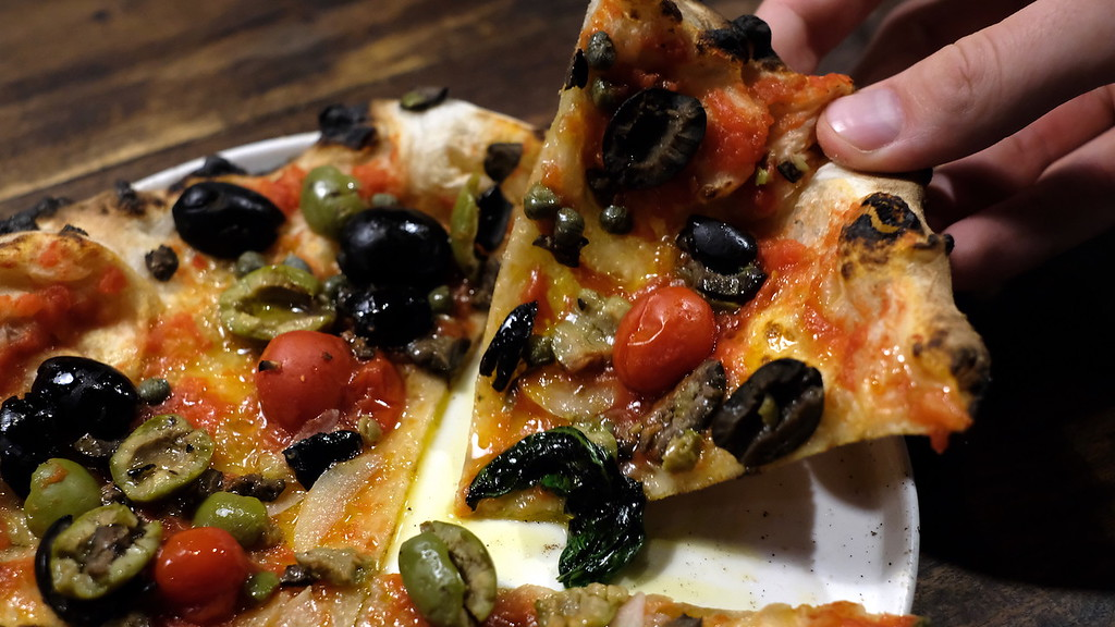 A slice of Olive pizza.