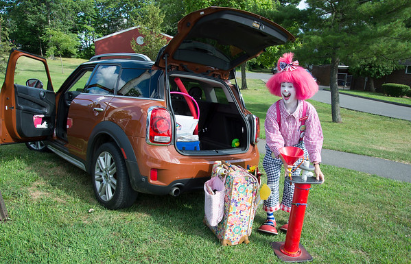 07/24/19 Wesley Bunnell   Staff Valentine the clown prepares to entertain at the annual Walk and Roll event on Wednesday afternoon at Walnut Hill Park. The Walk and Roll is hosted by the citys Commission on Persons with Disabilities and celebrates the signing of the American with Disabilities Act of 1990 and serves to raise awareness for improving the quality of life for all residents in the city, regardless of disability.