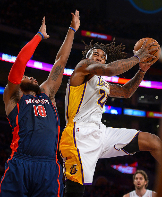 . Lakers� Jordan Hill drives up for two points as Detroit�s Greg Monroe defends on the play during first half action at Staples Center Sunday, November 17, 2013.  ( Photo by David Crane/Los Angeles Daily News )