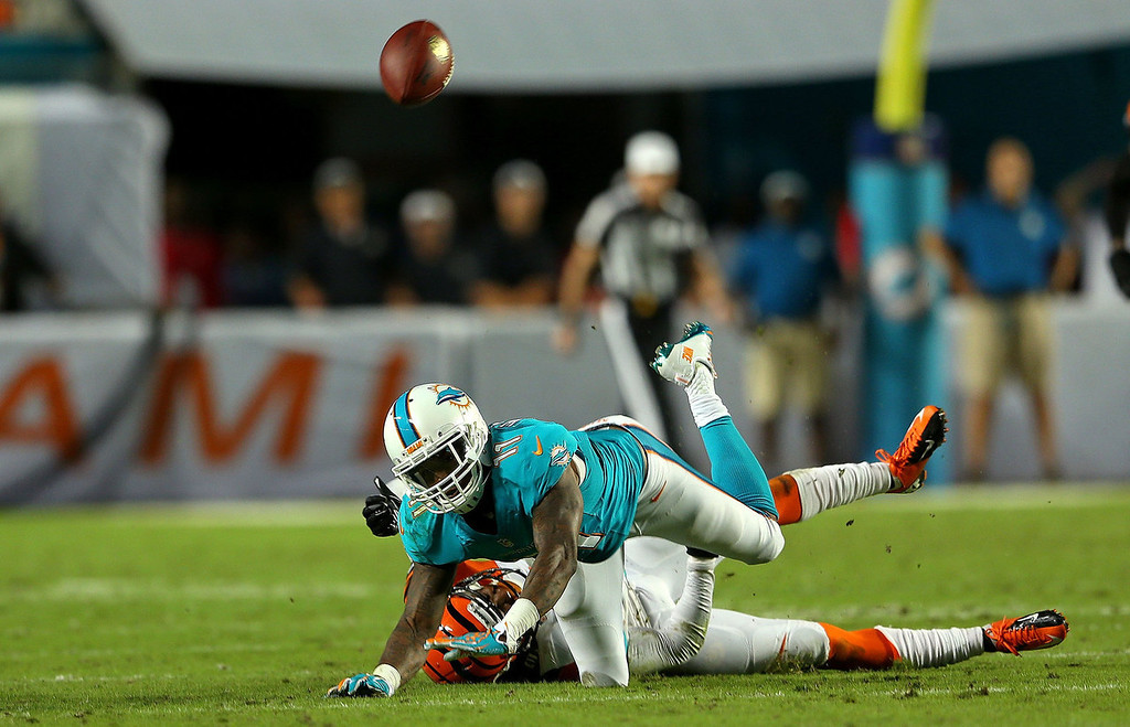 . Terence Newman #23 of the Cincinnati Bengals commits pass interference against Mike Wallace #11 of the Miami Dolphins during a game at Sun Life Stadium on October 31, 2013 in Miami Gardens, Florida. (Photo by Mike Ehrmann/Getty Images)