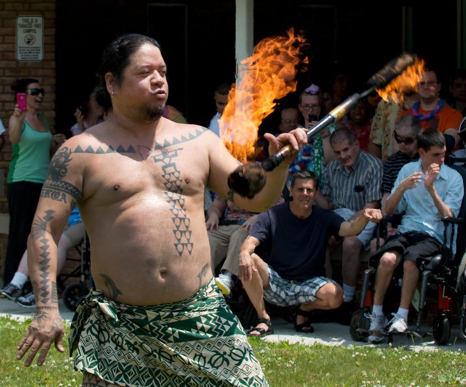 . Duncan Scott/DScott@News-Herald.com Fire dancer Ku\'u Awai performs during a luau on June 18 at the Lake County Board of Developmental Disabilities/Deepwood Vocational Guidance Center.