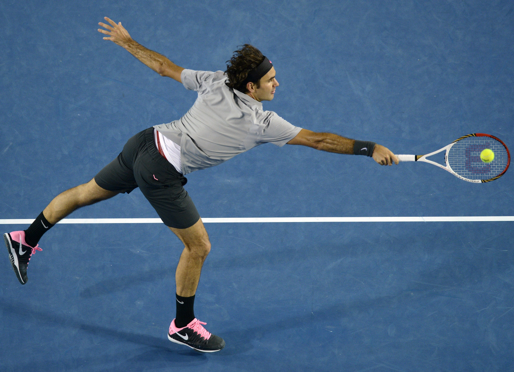 Description of . Switzerland's Roger Federer hits a return against Britain's Andy Murray during their men's singles semi-final match on day 12 of the Australian Open tennis tournament in Melbourne on January 25, 2013.  MANAN VATSYAYANA/AFP/Getty Images
