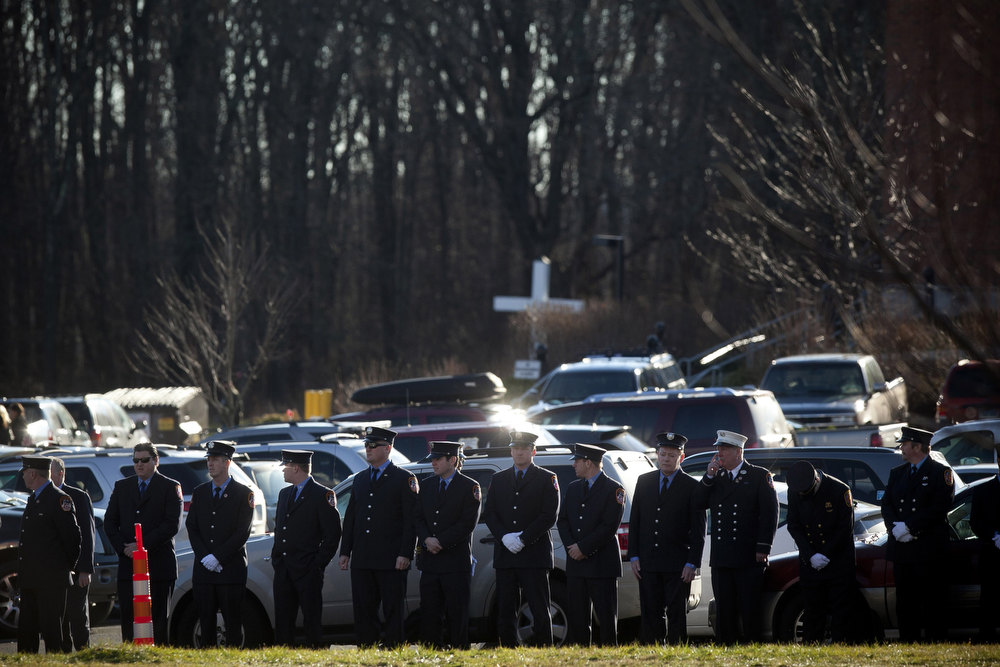 Description of . Firefighters attend the funeral for Daniel Barden, 7, a victim of the shooting at Sandy Hook Elementary School, at St. Rose of Lima Church December 19, 2012 in Newtown, Connecticut. Six victims of the Newtown school shooting are being honored at funerals and visitations across the state today. (Photo by Allison Joyce/Getty Images)