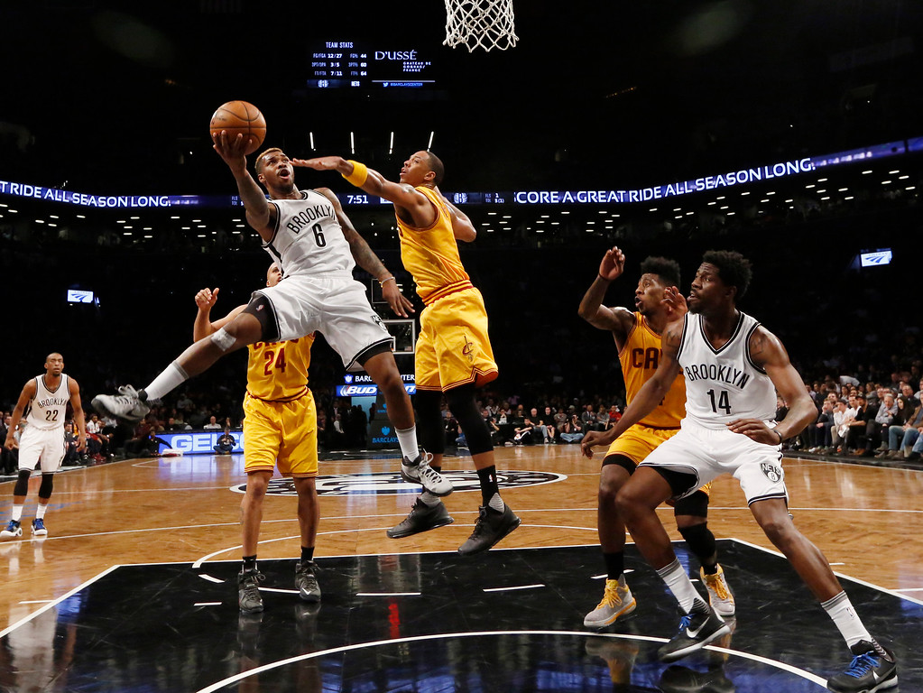 . Cleveland Cavaliers forward Channing Frye (9) defends Brooklyn Nets guard Sean Kilpatrick (6) in the first half of an NBA basketball game, Thursday, March 24, 2016, in New York. The Nets beat the Cavaliers 104-95. (AP Photo/Kathy Willens)
