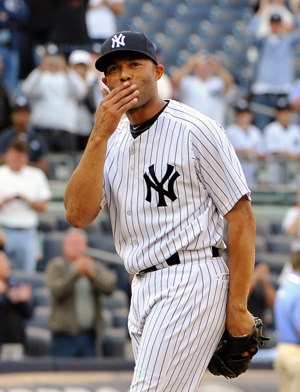 . In this Sept. 19, 2011 file photo, New York Yankees\' Mariano Rivera blows a kiss to the crowd to acknowledge cheers after recording his 602nd save as the Yankees beat the Minnesota Twins 6-4 in a baseball game at Yankee Stadium in New York. Now a baseball icon, Rivera will walk off the mound for the final time this weekend with one more record to set: highest percentage of a Hall of Fame electee.(AP Photo/Kathy Kmonicek, File)