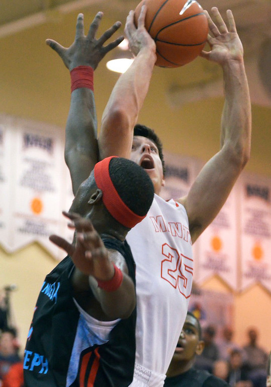 . Jeff Forman/JForman@News-Herald.com Caleb Potter, Mentor, shoots past Carlton Bragg, VASJ, during the first quarter of Mentor\'s 82-71 loss Sunday in the Dunk4Diabetes Shootout at Walsh University in North Canton.