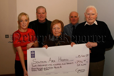 The Kevin Heaney Memorial Christmas 4 mile road race in aid of Southern Area Hospice raised £2974-30 and 33 euro, Presenting the Cheque to Denise O'Neill (community fundraiser) left, are Jim & Doris and Paul Heaney and Sean Mc Cracken, 07W7N67