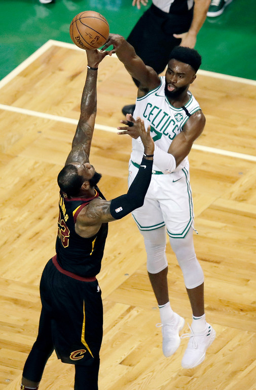 . Boston Celtics guard Jaylen Brown passes the ball over Cleveland Cavaliers forward LeBron James, left, during the first half in Game 7 of the NBA basketball Eastern Conference finals, Sunday, May 27, 2018, in Boston. (AP Photo/Charles Krupa)
