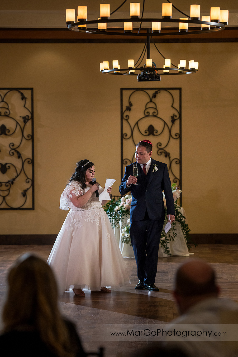jewish bride and groom welcoming guests during wedding reception at Livermore Garre Vineyard and Winery
