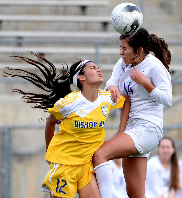 . Diamond Bar\'s Helena Kisor (14) with the header over Bishop Amat\'s Jaime Peters (12) in the first half of a CIF-SS second round prep playoff soccer match at Diamond Bar High School in Diamond Bar, Calif., on Wednesday, Feb.26, 2014. Diamond Bar won 3-2. (Keith Birmingham Pasadena Star-News)