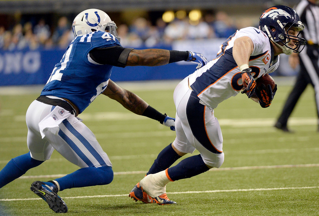 . Denver Broncos wide receiver Wes Welker (83) gets away from Indianapolis Colts strong safety Antoine Bethea (41) as he picks up a few yards during the third quarter October 20, 2013 at Lucas Oil Field. Photo by John Leyba/The Denver Post)