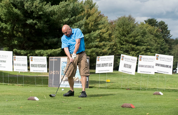 09/24/19 Wesley Bunnell | StaffrrBristol Police Ofc. Alan Clark tees off during the Ed Beardsley Little League Challenger Golf Tournament at Chippanee Golf Club on Tuesday afternoon.