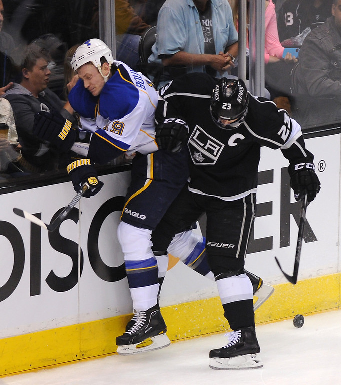 . The Kings\' Dustin Brown slams the St. Louis Blues\' Jay Bouwmeester into the boards in the first period, Monday, May 6, 2013, at Staples Center. (Michael Owen Baker/Staff Photographer)