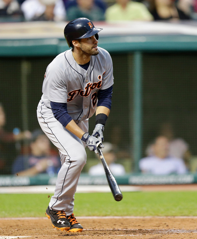. Detroit Tigers\' J.D. Martinez hits a double off Cleveland Indians starting pitcher Corey Kluber in the sixth inning of a baseball game on Friday, June 20, 2014, in Cleveland. (AP Photo/Tony Dejak)