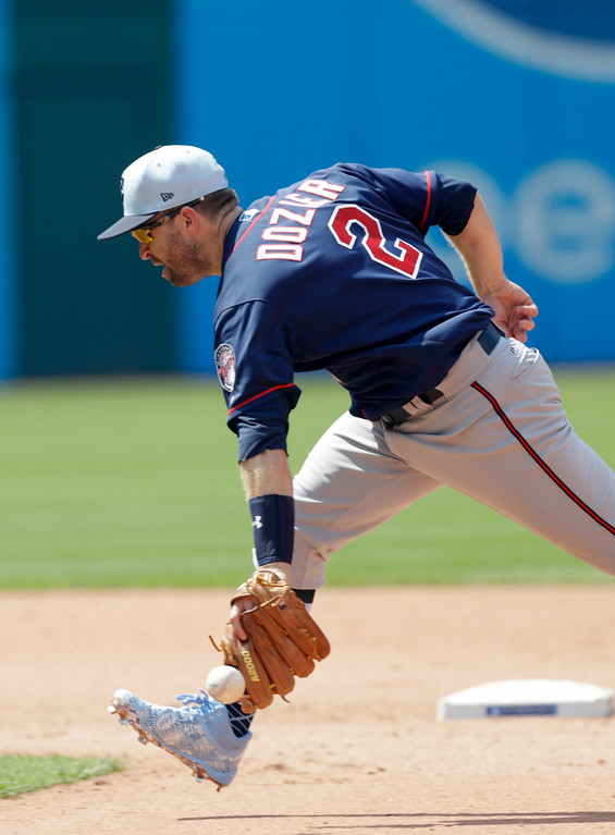 . Minnesota Twins\' Brian Dozier can\'t get to a ball hit by Cleveland Indians\' Michael Brantley in the seventh inning of a baseball game, Sunday, June 17, 2018, in Cleveland. Brantley was safe at first base. The Indians won 4-1. (AP Photo/Tony Dejak)