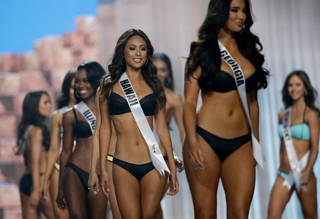. In this May 11, 2017, photo, Miss Hawaii USA Julie Kuo competes during a preliminary competition for Miss USA in Las Vegas. Kuo was born in Tainan, Taiwan, and moved to Hawaii with her family. Five of the contestants vying for the Miss USA title this year were born in other countries and now U.S. citizens. (AP Photo/John Locher)