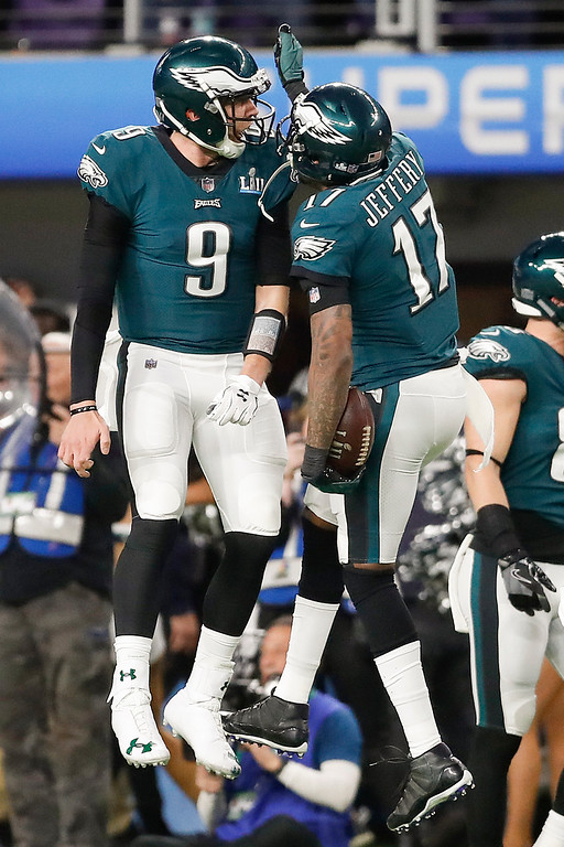 . Philadelphia Eagles\' Alshon Jeffery (17) celebrates his touchdown catch with quarterback Nick Foles (9) during the first half of the NFL Super Bowl 52 football game against the New England Patriots Sunday, Feb. 4, 2018, in Minneapolis. (AP Photo/Jeff Roberson)