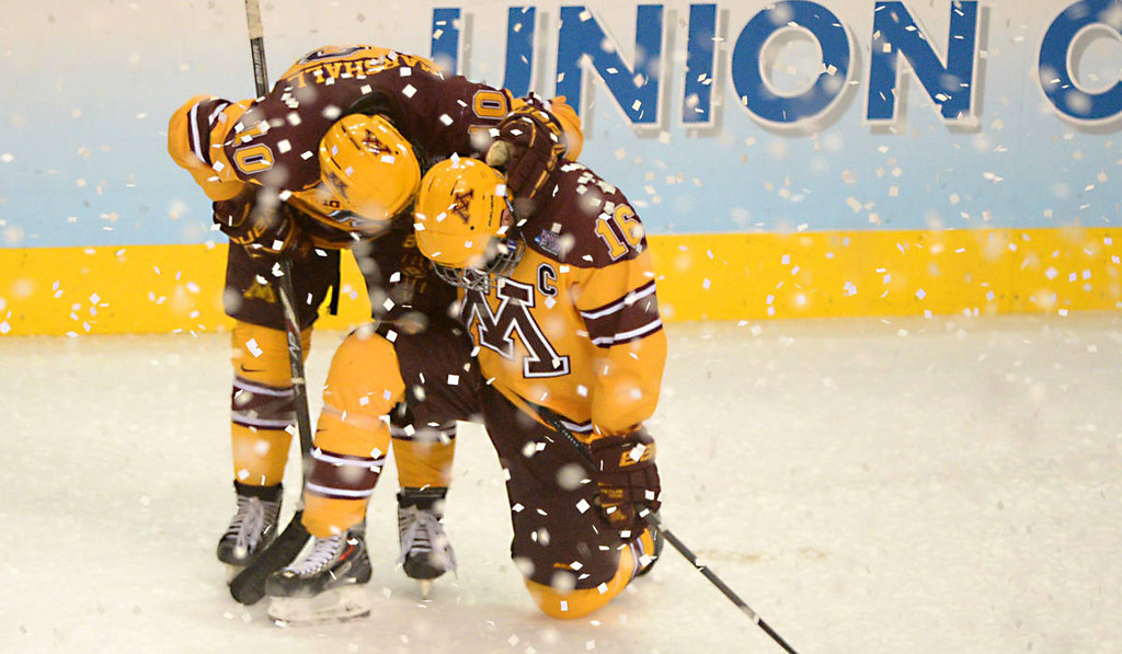 . Minnesota junior defenseman Ben Marshall consoles Minnesota senior forward Nate Condon after Union College beat the Gophers, 7-4 in the NCAA Frozen Four Championship Game at the Wells Fargo Center in Philadelphia, Saturday, April 12, 2014. (Pioneer Press: John Autey)