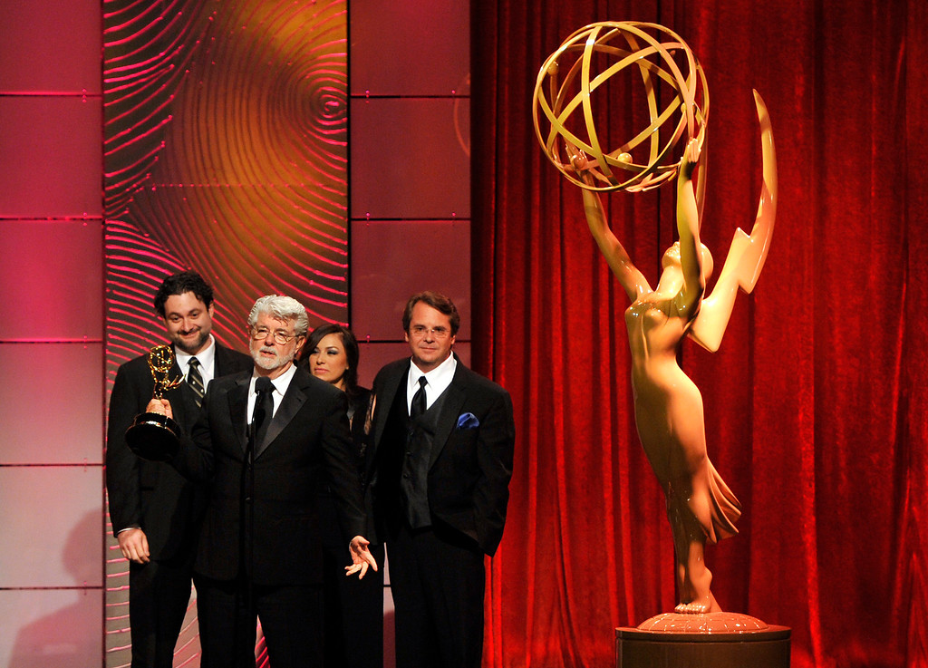 """. George Lucas, second from left, and the crew of \""""Star Wars: The Clone Wars\"""" accept the award for outstanding special class animated program at the 40th Annual Daytime Emmy Awards on Sunday, June 16, 2013, in Beverly Hills, Calif. (Photo by Chris Pizzello/Invision/AP)"""