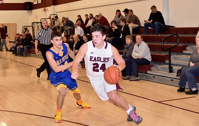 AMHS Varsity Boys Basketball vs Poultney photos by Gary Baker