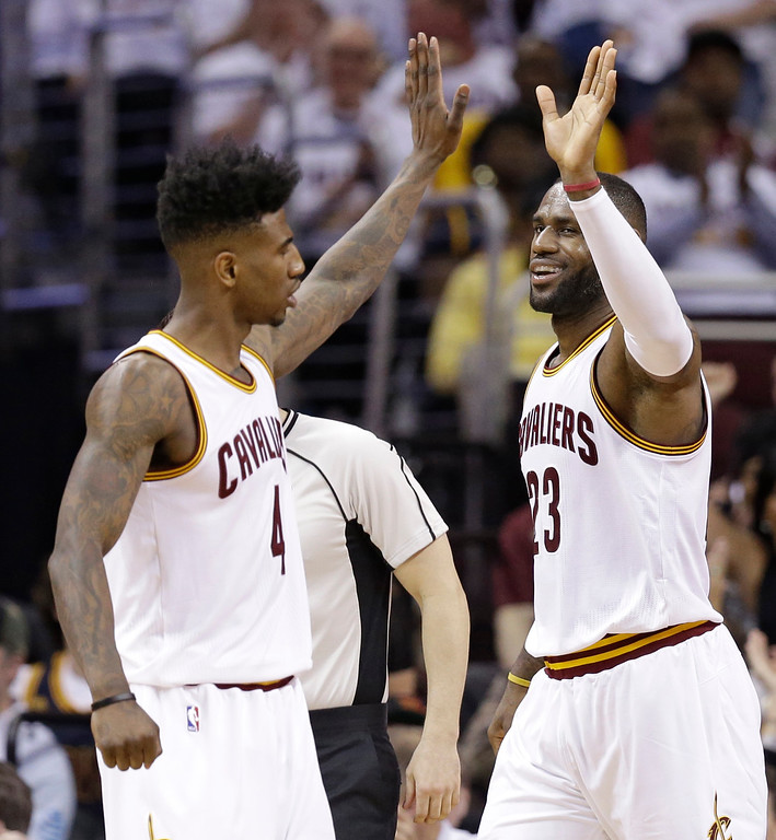 . Cleveland Cavaliers\' LeBron James, right, and Iman Shumpert celebrate during the second half in Game 2 of a first-round NBA basketball playoff series, Wednesday, April 20, 2016, in Cleveland. The Cavaliers won 107-90. (AP Photo/Tony Dejak)